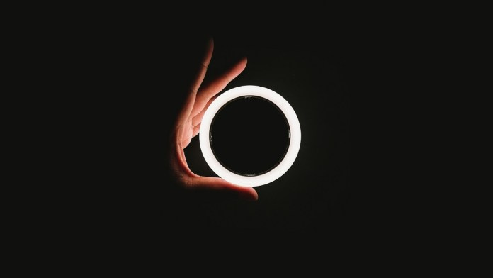 Circle, a hand with a white circle