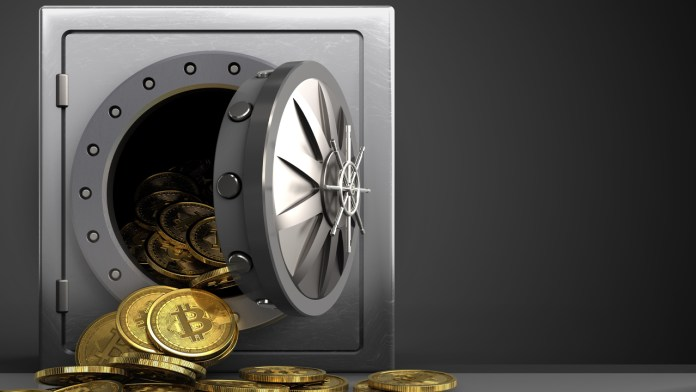 Picture of a vault with bitcoins pouring out of it