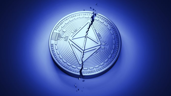 Picture of an Ethereum coin with a crack through the middle of it