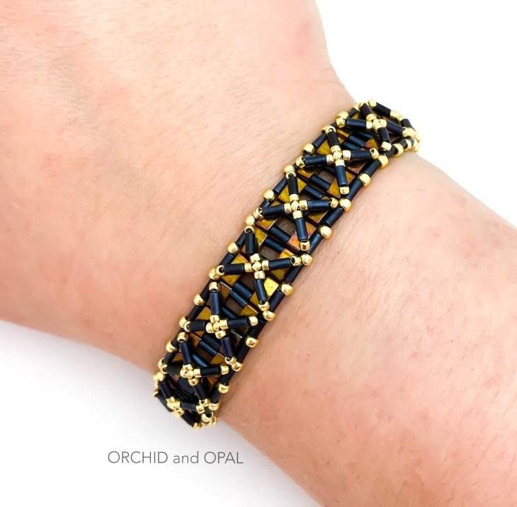 half nexus bracelet black gold