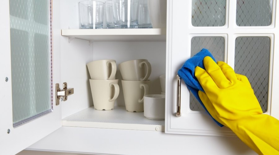 Hand Cleaning a Kitchen Cabinet Orchid Cleaning Services