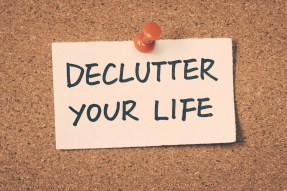 declutter your life note pinned on the bulletin board