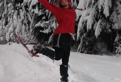 woman snowshoe jumping