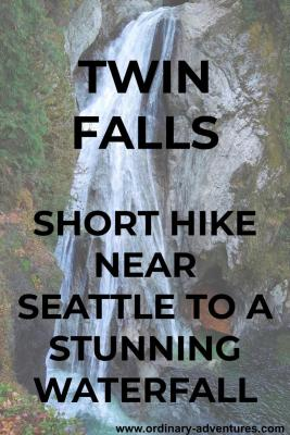 A wide and high waterfall cascades over a vertical rock face. There are trees and green shrubs around it. Text reads: Twin Falls. Short hike near seattle to a stunning waterfall