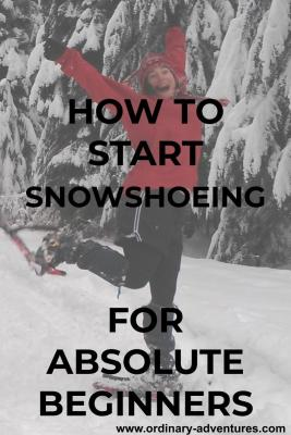 A person is jumping in the air wearing snowshoes in the snow, surrounded by snowy trees. She is smiling and wearing a red hat, red jacket and black leggings and shorts. Text reads: How to start snowshoeing for absolute beginners