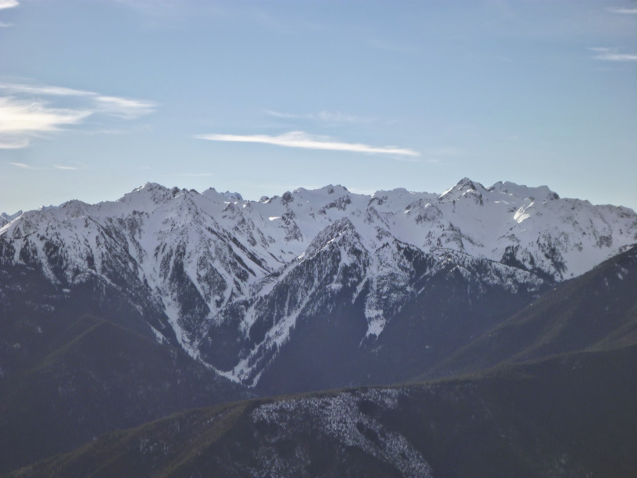 Distant snow covered mountains across a valley at Hurricane Ridge in Olympic National Park