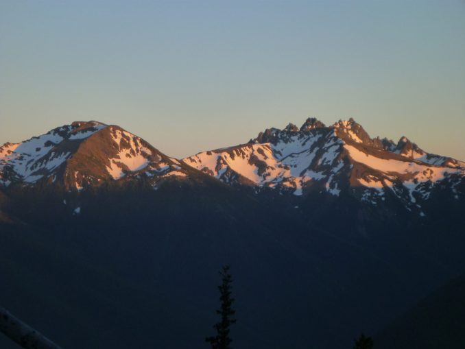 Alpenglow on mountains at sunset from Deer park in Olympic National Park