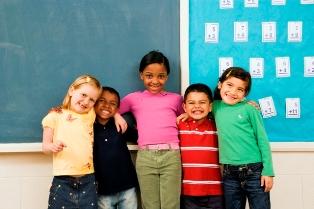 Classroom buddies by chalkboard