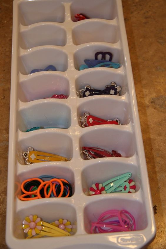organise girls' hair accessories in a ice cube tray