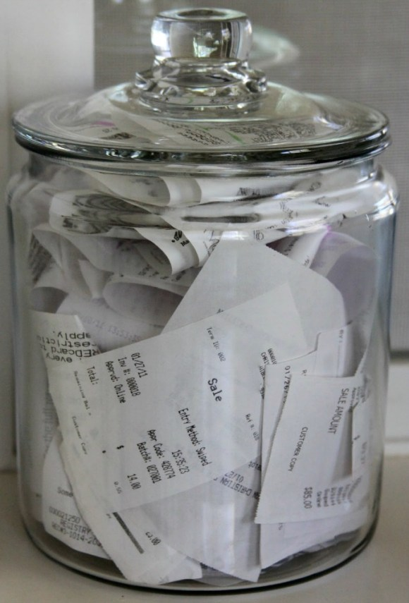 organise receipts in a glass jar