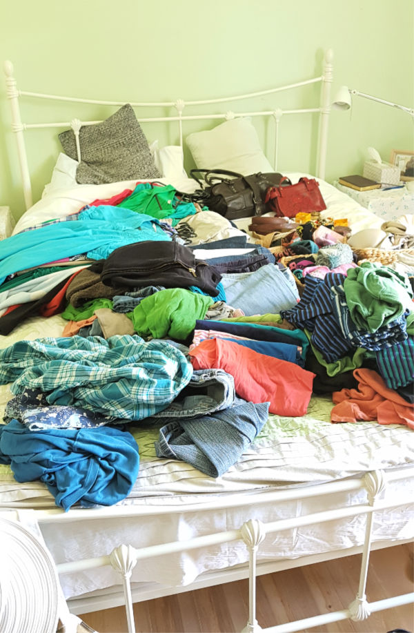 purge closet by taking your clothes out and putting them on the bed