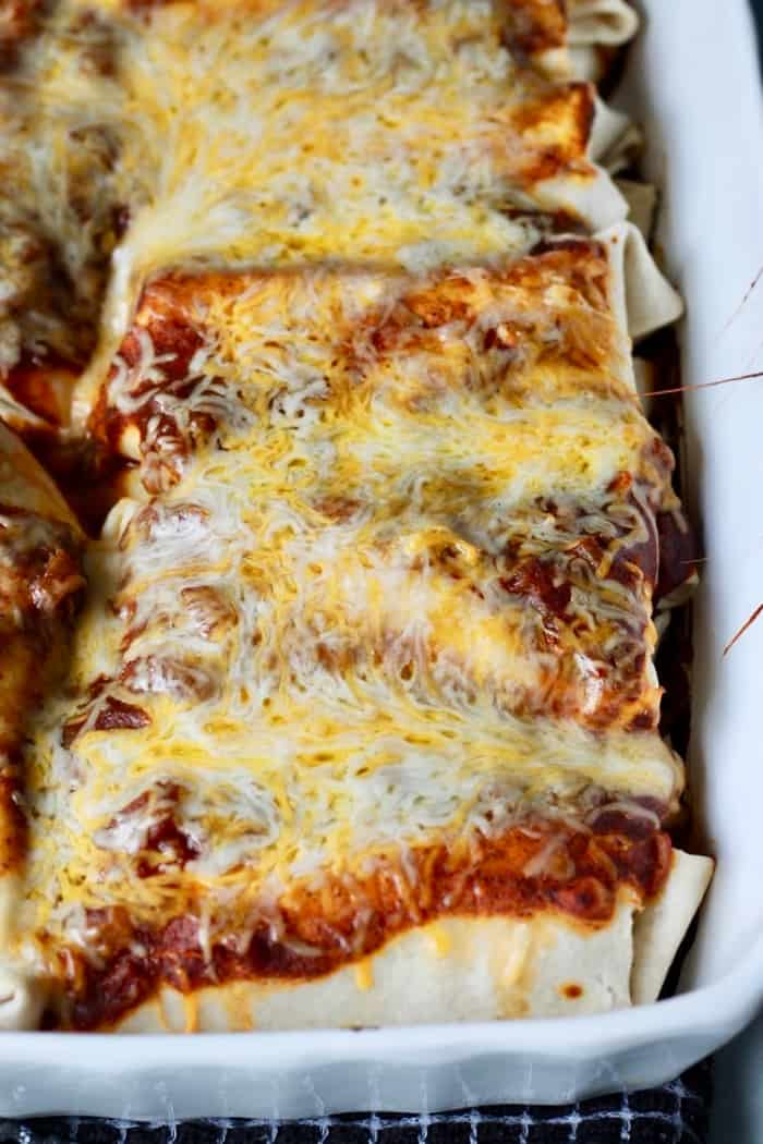 easy beef enchiladas after they come out of the oven