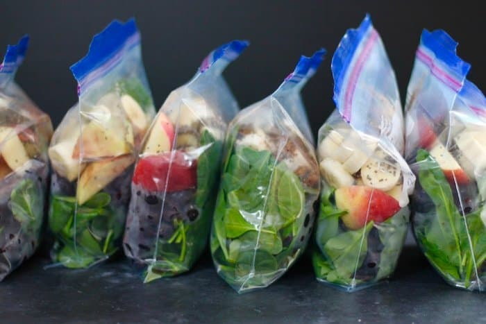 Make ahead smoothie packs filled with ingredients for a blueberry spinach smoothie.
