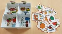 Material manipulativo tipo TEACCH para trabajar de forma lúdica la clasificación de los alimentos, distribuyéndolos en diferentes cajas de cartón, atendiendo al menú: primer plato, segundo plato, postres y bebidas.