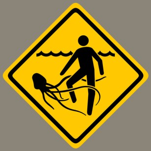 It Came From The Depths cover sticker - yellow and black diamond-shaped warning sign depicting a swimmer being attacked by a squid.