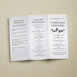 An unfolded A4 tri-fold leaflets in a classic black and white styling