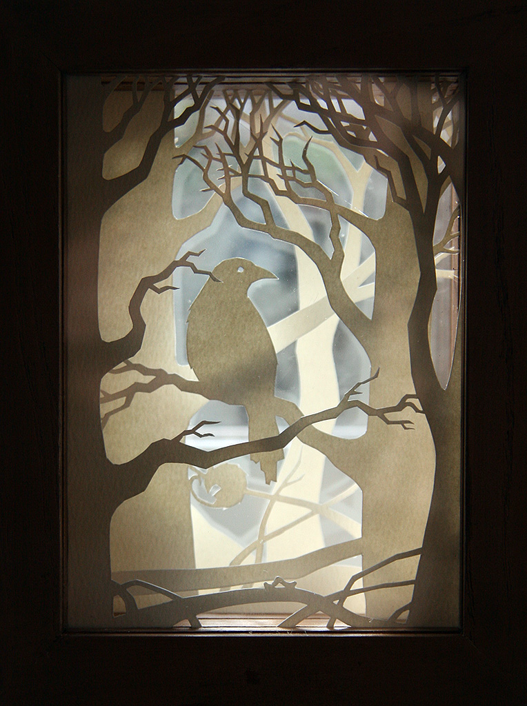 Crow Wood paper-cut viewpane (backlit)