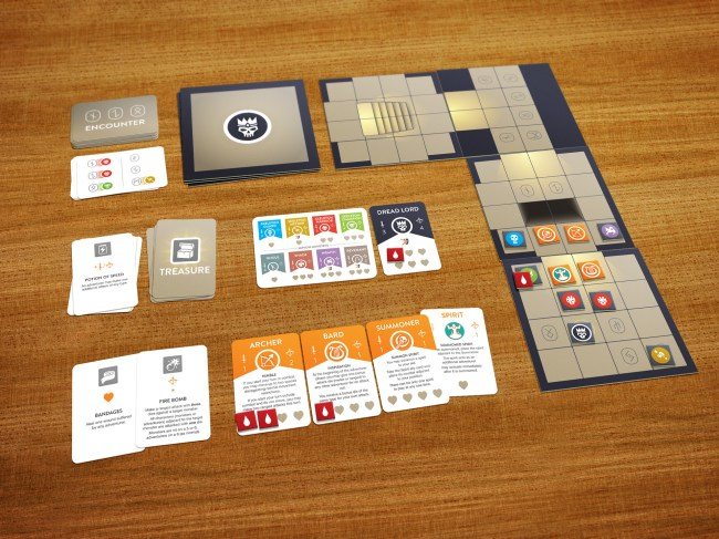 Boardgame in progress, with tiles laid out to create a duneon and character cards and item cards surrounding the main play area.