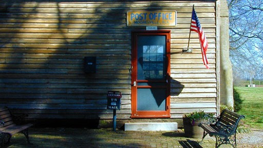 U.S. flag flying at the Post Office in Mooresville, Alabama.  This is the oldest operating post office in the state.  Image from Original Green