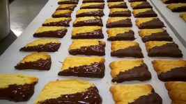Sablé half-dipped in chocolate
