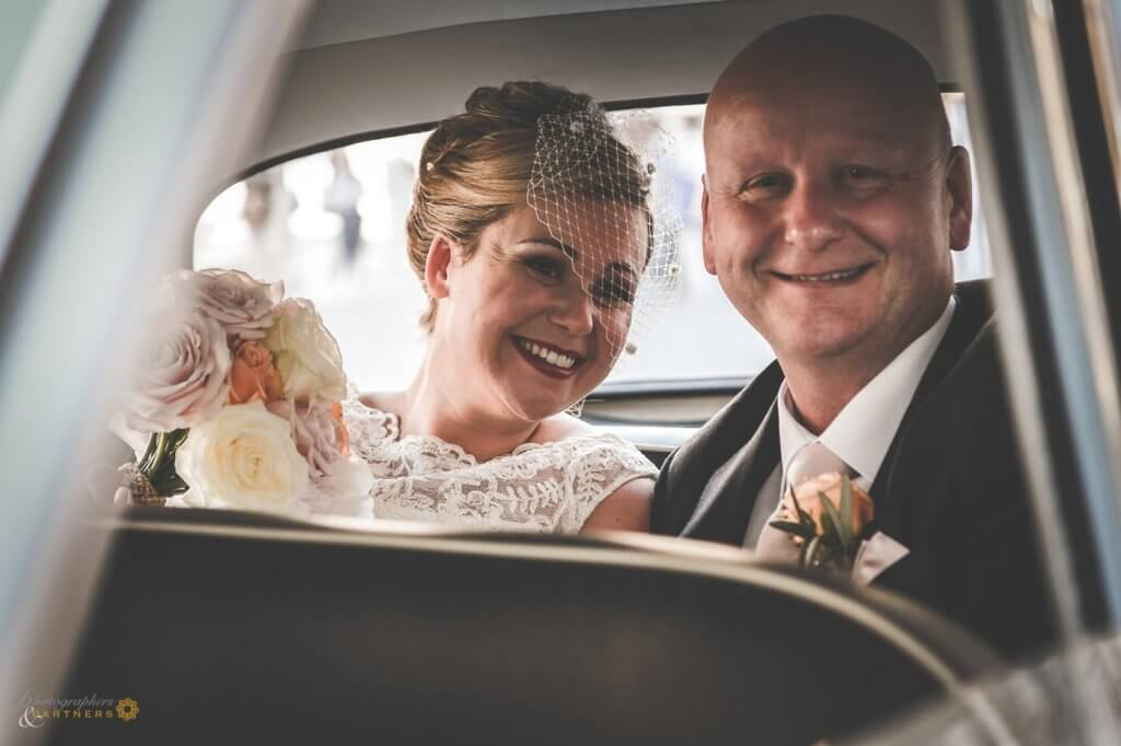 The bride reaches the location with her father