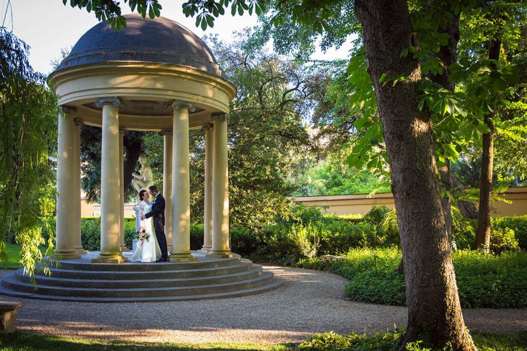 Bride and groom explore the hotel garden