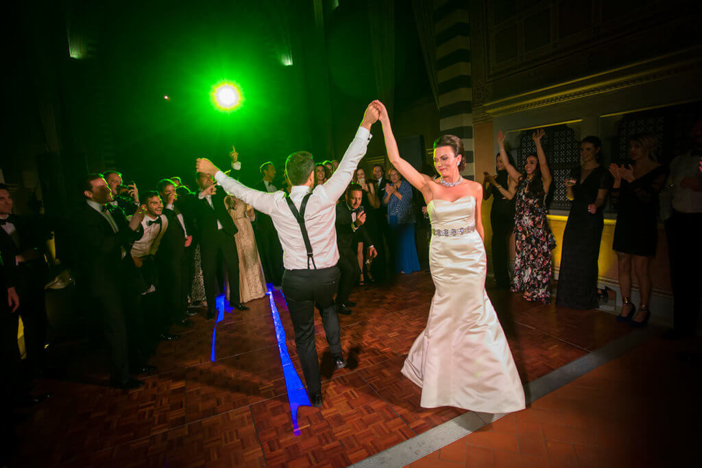Bride and groom have a dance party in the old convent room