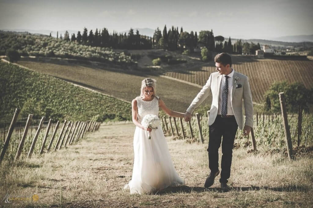 Emma & Edward walk through the vineyard