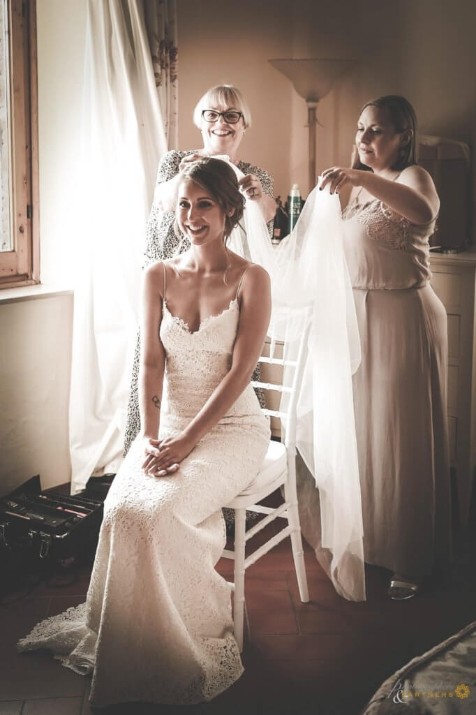 The bride prepares for the ceremony with her bridesmaids