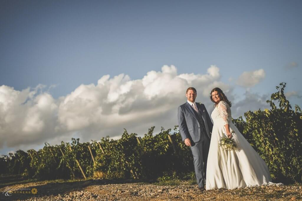 Emma & Edwar walk through the vineyard