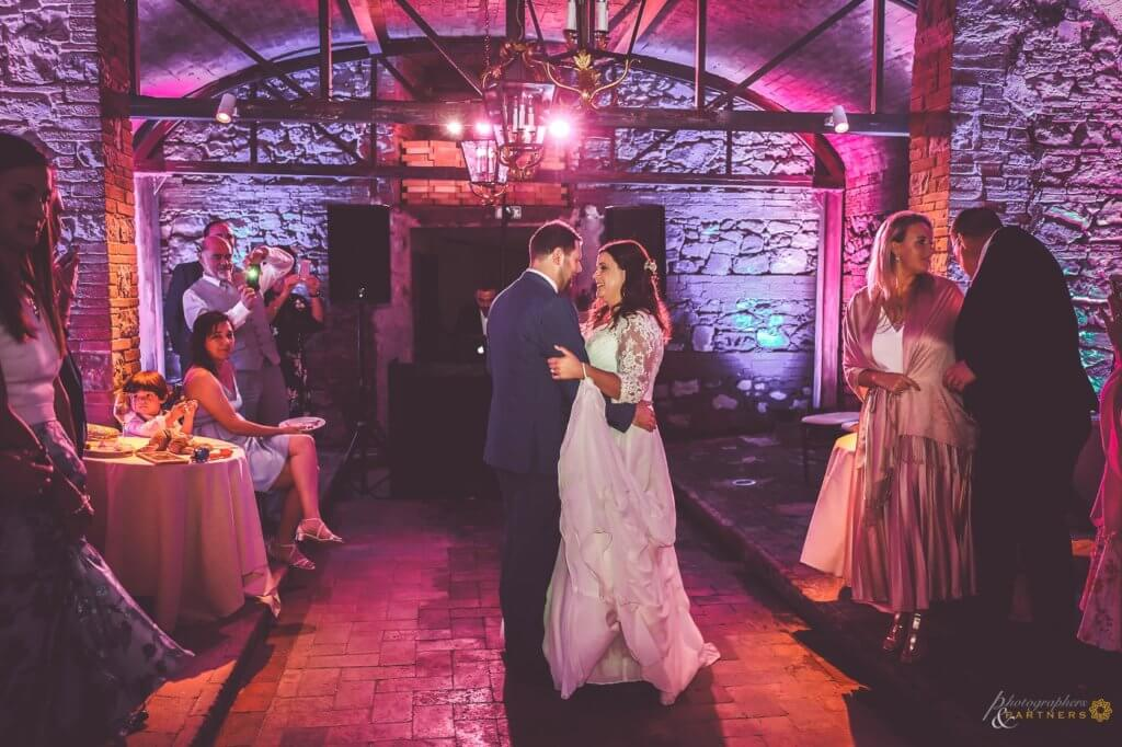 Amy & Elliot have a romantic first dance in the historical wine cellar