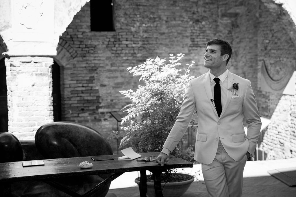 The groom waits for the bride at the altar