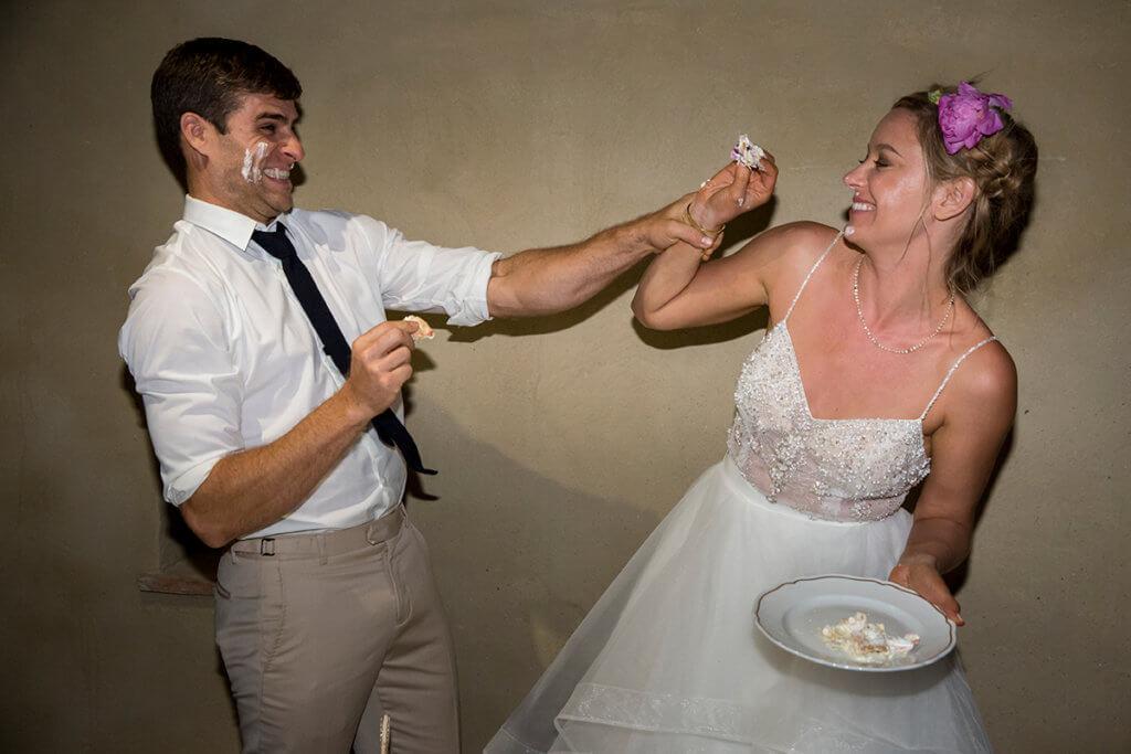 Lauren & Ben play with the cake