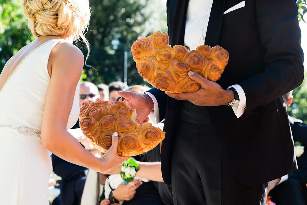 Bride and Groom break bread according to their tradition