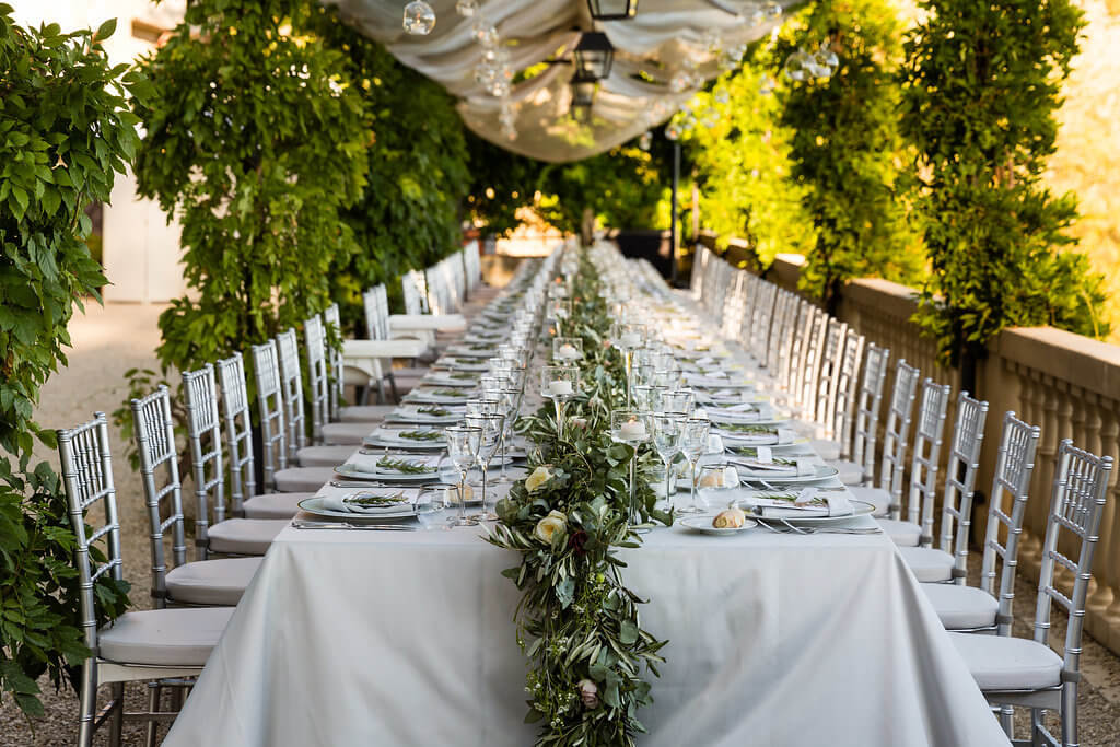 A long table is prepared for the wedding dinner