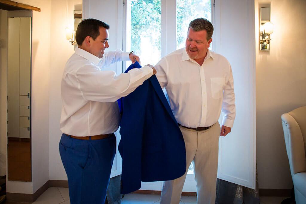 Tim helps Dan to wear his jacket