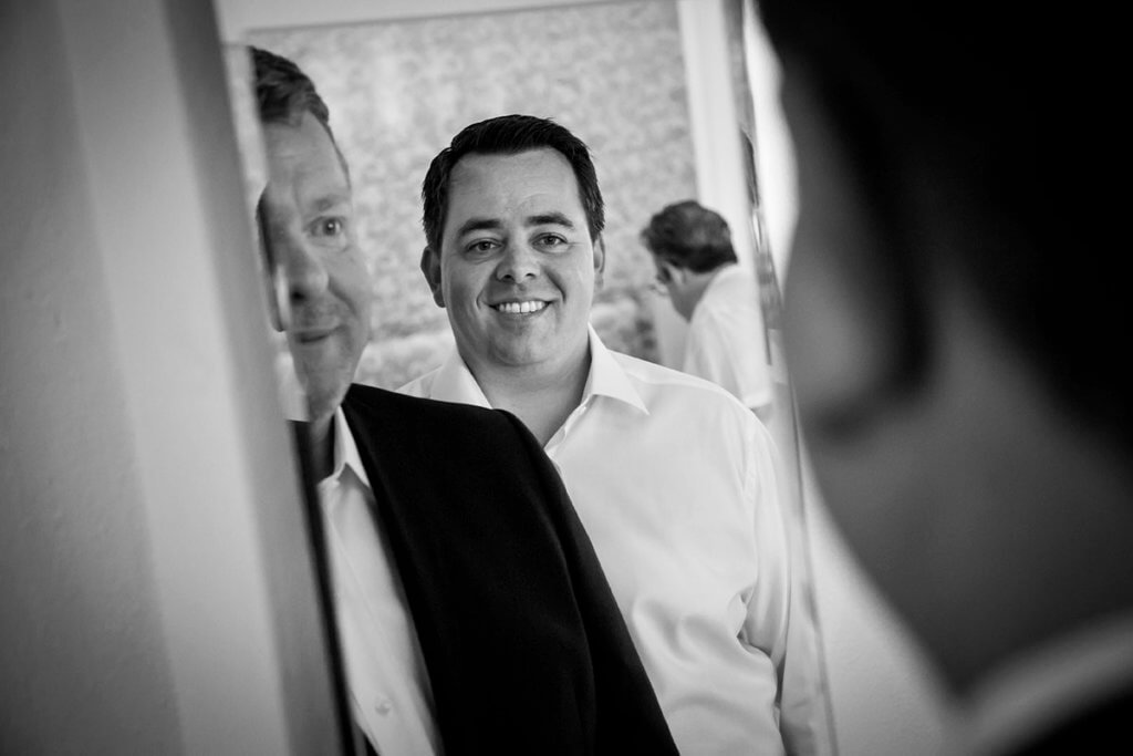 Tim looks Dan through the mirror