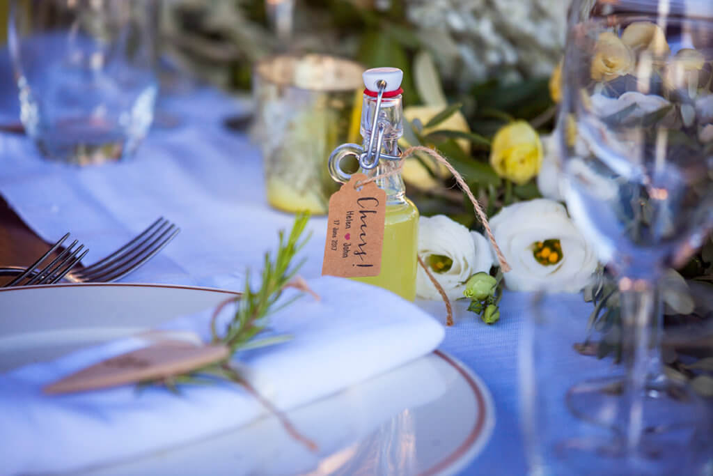 the newlyweds offer a limoncello bottle to the guests