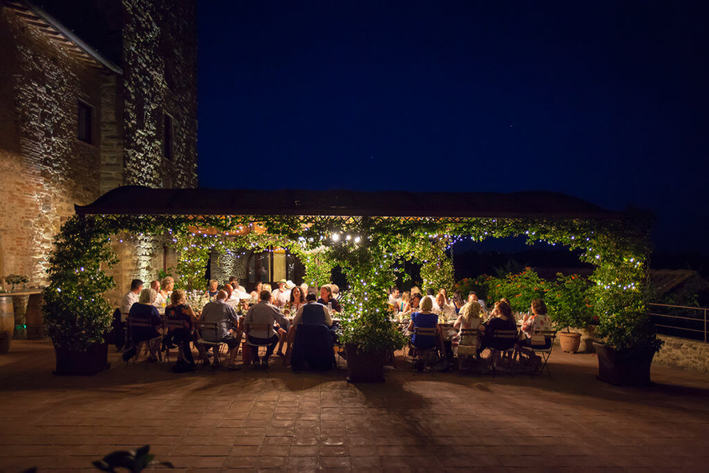 The newlyweds and their guests enjoy the wedding dinner
