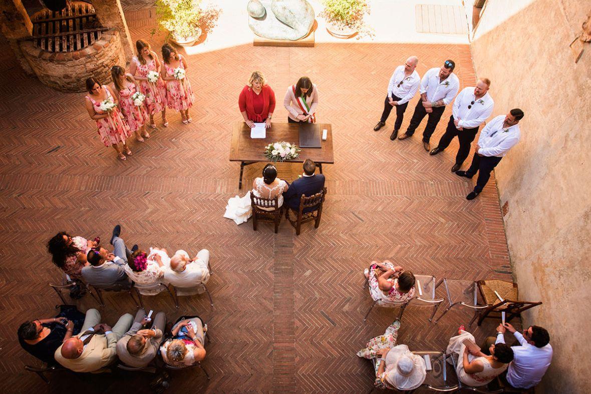 Bride and groom listen to registrar speech during the wedding ceremony