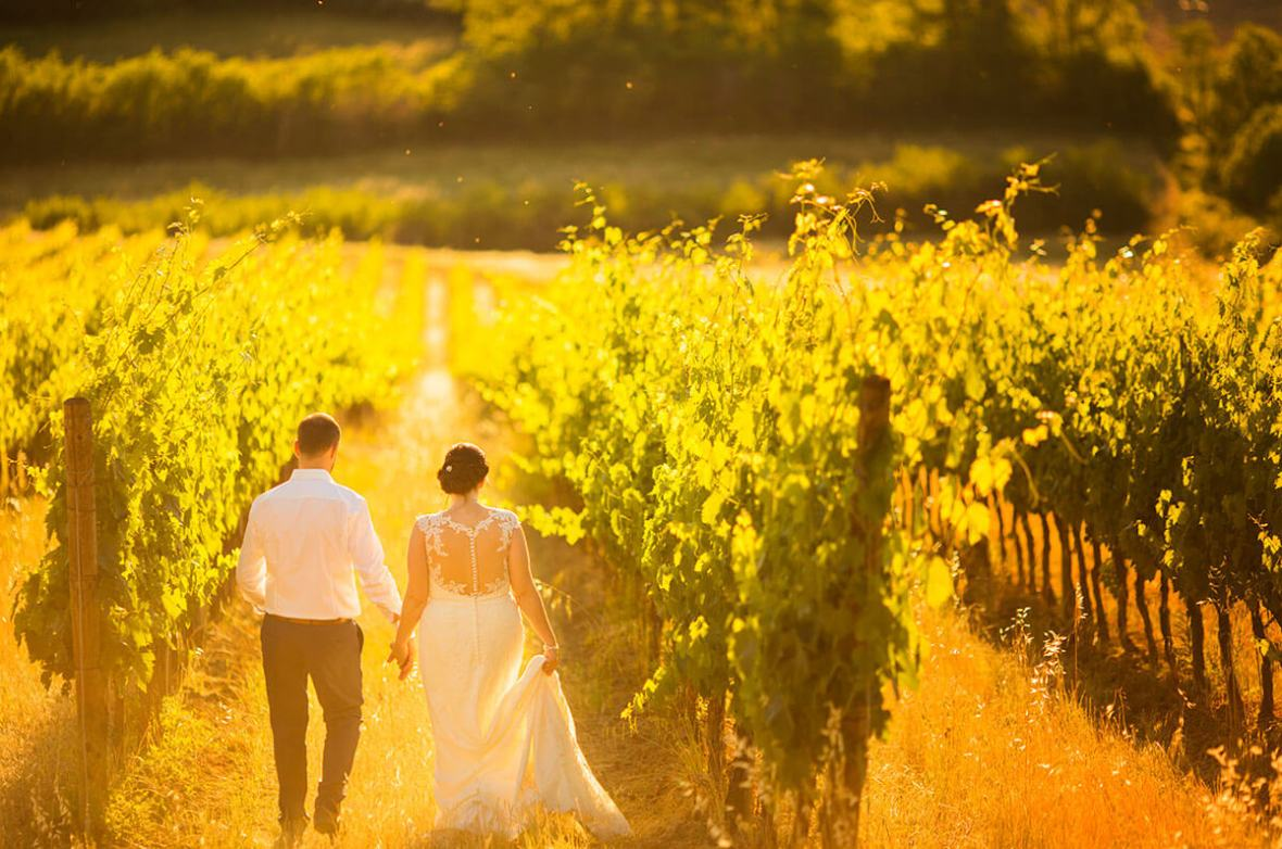Anya & James walk through the vineyard
