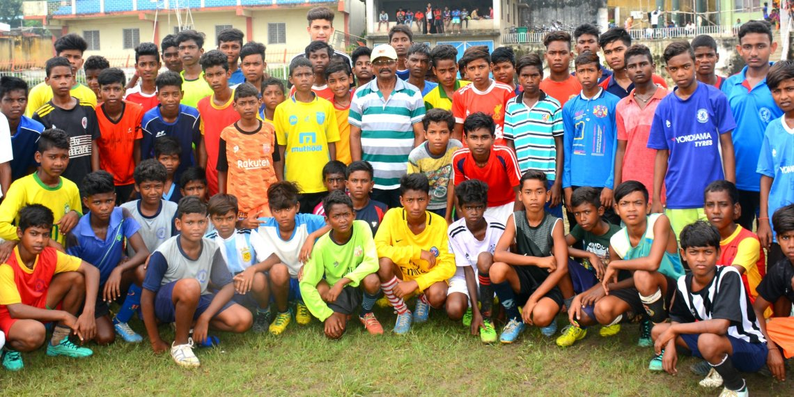 Footballers pose for a photograph along with officials during the two-day selection camp in Sambalpur, Saturday