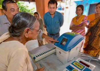 Election officials demonstrate the functioning of EVM and VVPAT for voters (PTI)