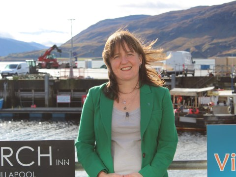 Maree Todd standing against railings at Ullapool Harbour