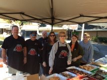 The Uncle Bucks BBQ crew at a catering event using their Wetsounds stealth bar.