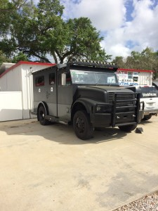 Custom Armored truck limo with custom bumper, hid headlights, light bar and matte black dip