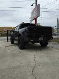 Next Level Edition Ford Raptor with color matched bumper and Rhino Lined trim and Rigid Industries SR series flush mount reverse lights.