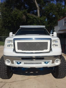 2008 GMC Sierra 2500 with full custom molded Rigid Headlights and bumper shroud.