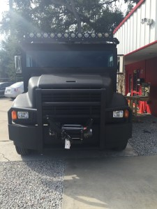 Custom removable winch on custom armored truck limo
