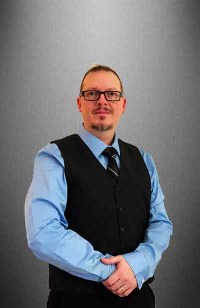 Chris Dark Grey Background 400x615 - Meet the Team